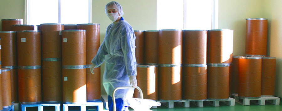 worker with chemical drums