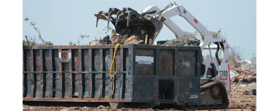Trash dumpster on construction site