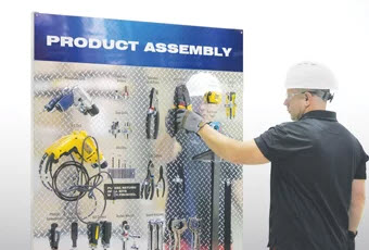 worker at tool board