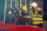 Workers discussing workplace safety